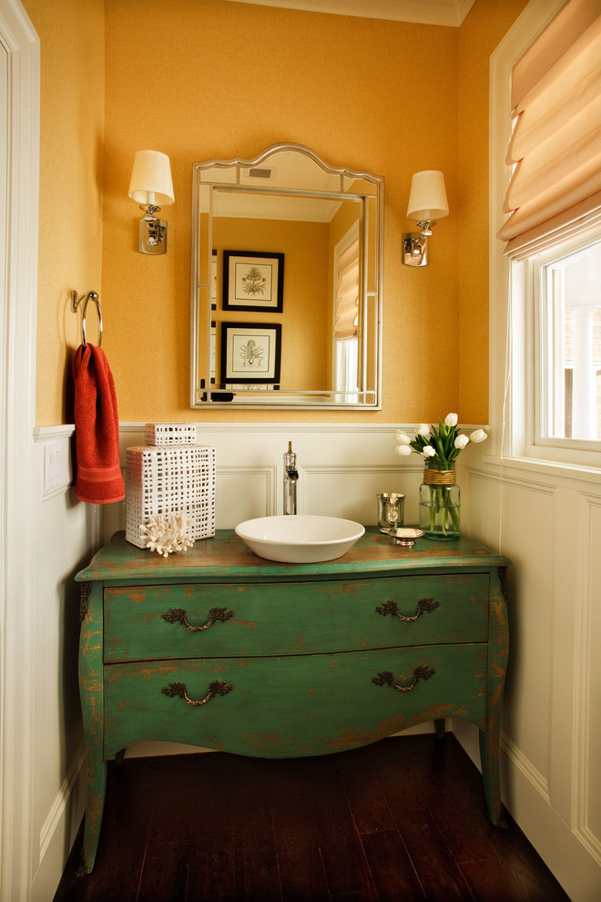 Small elegant dark wood floor powder room photo in Portland with a vessel sink, furniture-like cabinets and green cabinets