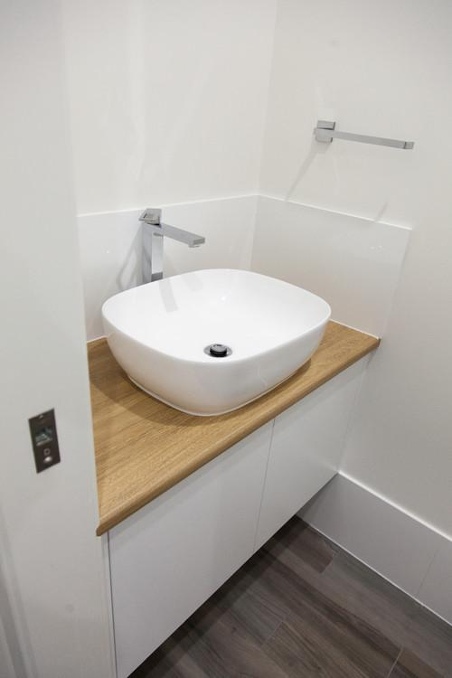 tall basin mixer with white basin