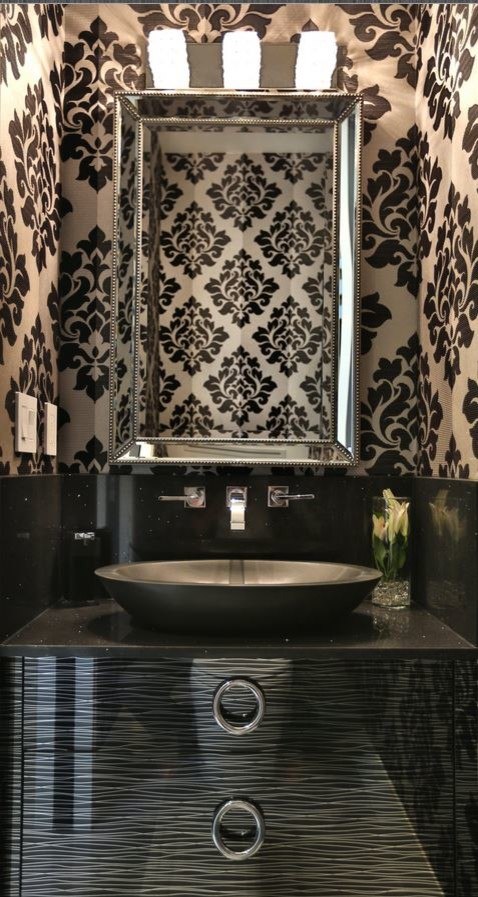 Small trendy white tile and porcelain tile porcelain tile powder room photo in Toronto with a vessel sink, flat-panel cabinets, black cabinets, granite countertops, a two-piece toilet and black countertops