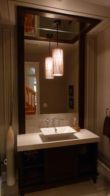 Example of a mid-sized arts and crafts powder room design in Vancouver with flat-panel cabinets, black cabinets, beige walls and a vessel sink