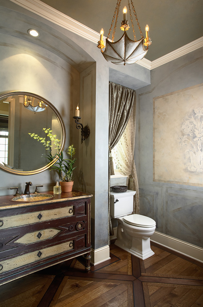 Powder room - traditional dark wood floor powder room idea in Minneapolis with a two-piece toilet