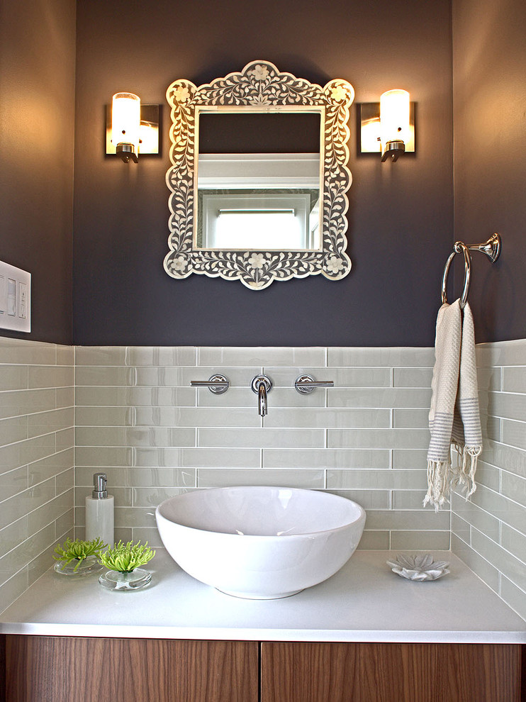 Powder room - small contemporary gray tile and glass tile powder room idea in San Francisco with a vessel sink and quartz countertops