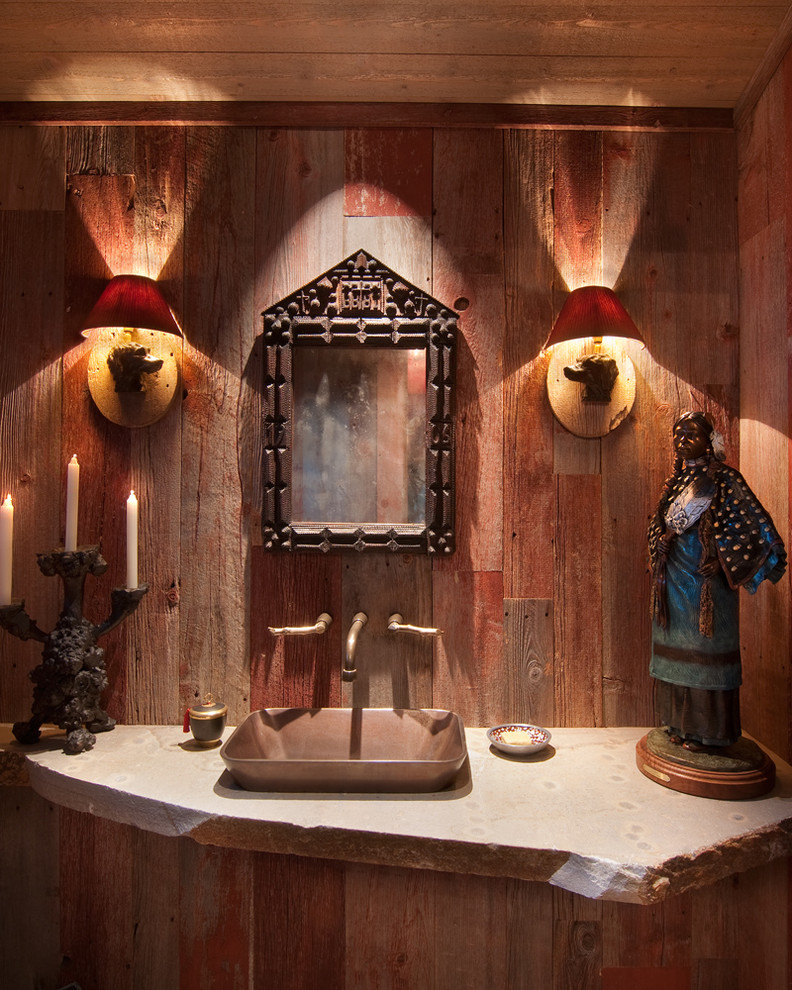 Inspiration for a rustic powder room remodel in Sacramento with a vessel sink