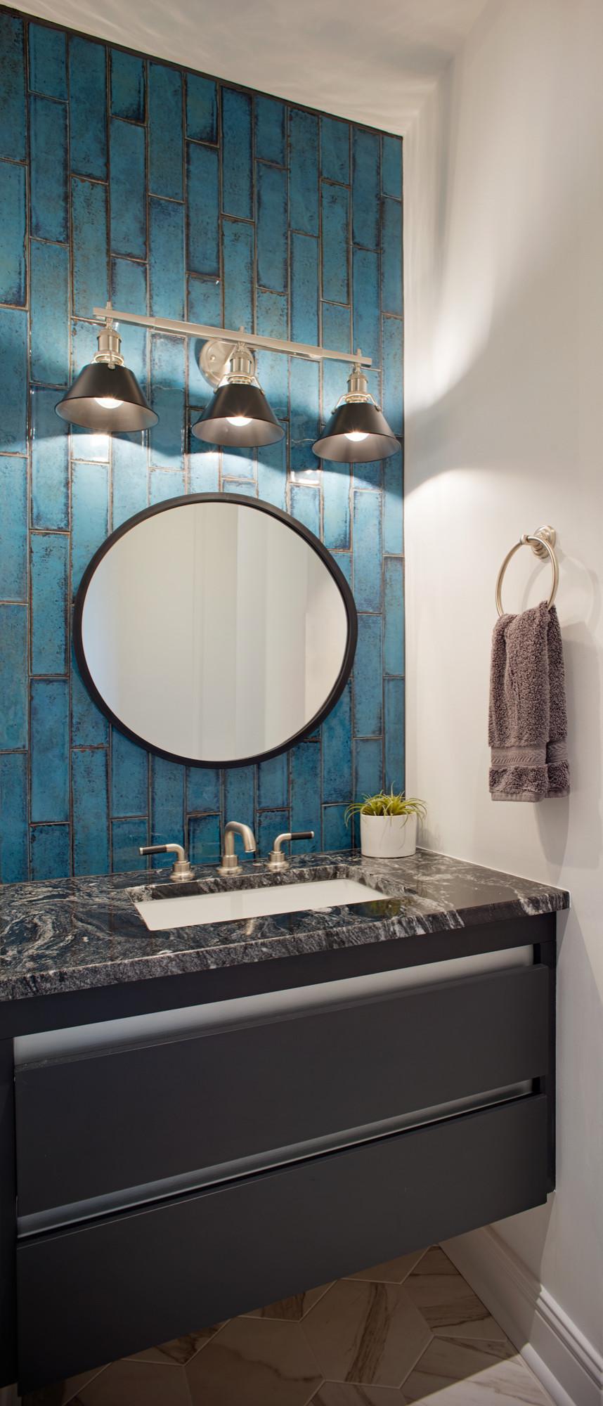Powder room with dramatic blue tile backsplash
