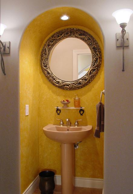 Powder Room with Round Mirror mediterranean-powder-room