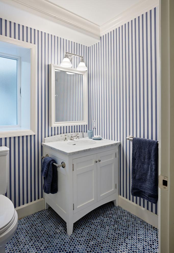 Powder room - traditional mosaic tile blue floor powder room idea in San Francisco with multicolored walls
