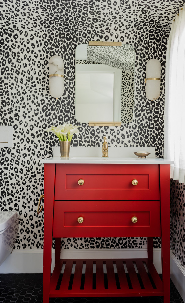 Example of a mid-sized classic white tile and ceramic tile ceramic tile, black floor and wallpaper powder room design in Boston with an undermount sink, marble countertops, white countertops, shaker cabinets, red cabinets, multicolored walls and a freestanding vanity