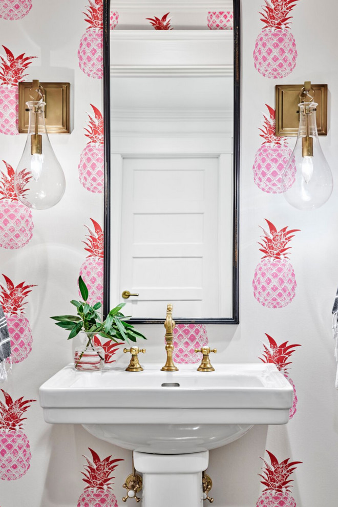 Beach style powder room photo in Nashville with multicolored walls and a pedestal sink