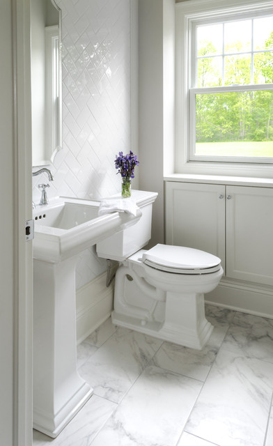 Inspiration for a mid-sized transitional white tile and ceramic tile marble floor and gray floor powder room remodel in Cleveland with a two-piece toilet, white walls and a pedestal sink