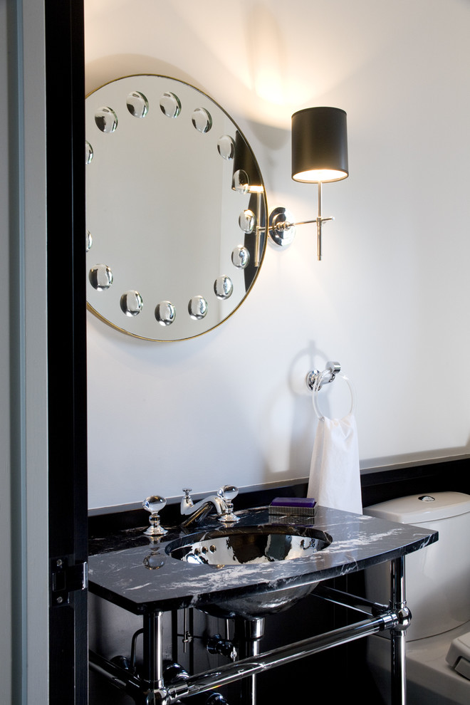 Powder room - transitional powder room idea in Boston with a console sink