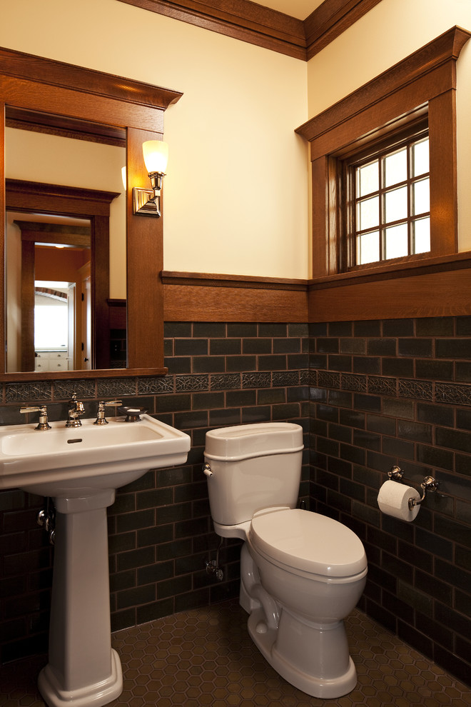 Inspiration for a craftsman subway tile powder room remodel in Other with a pedestal sink