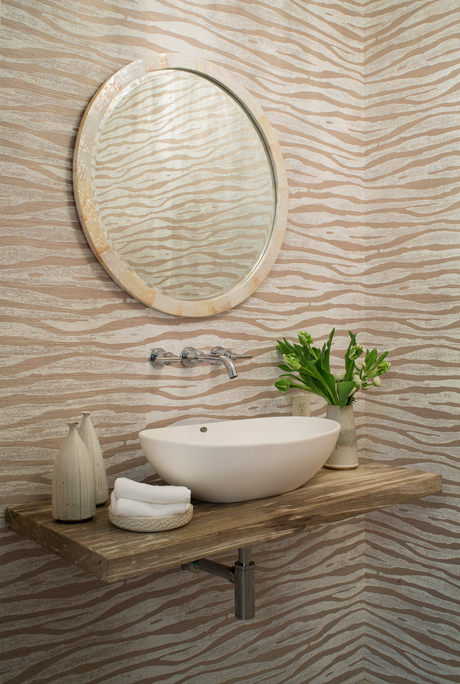 Small transitional powder room photo in Santa Barbara with multicolored walls, a vessel sink, wood countertops and brown countertops