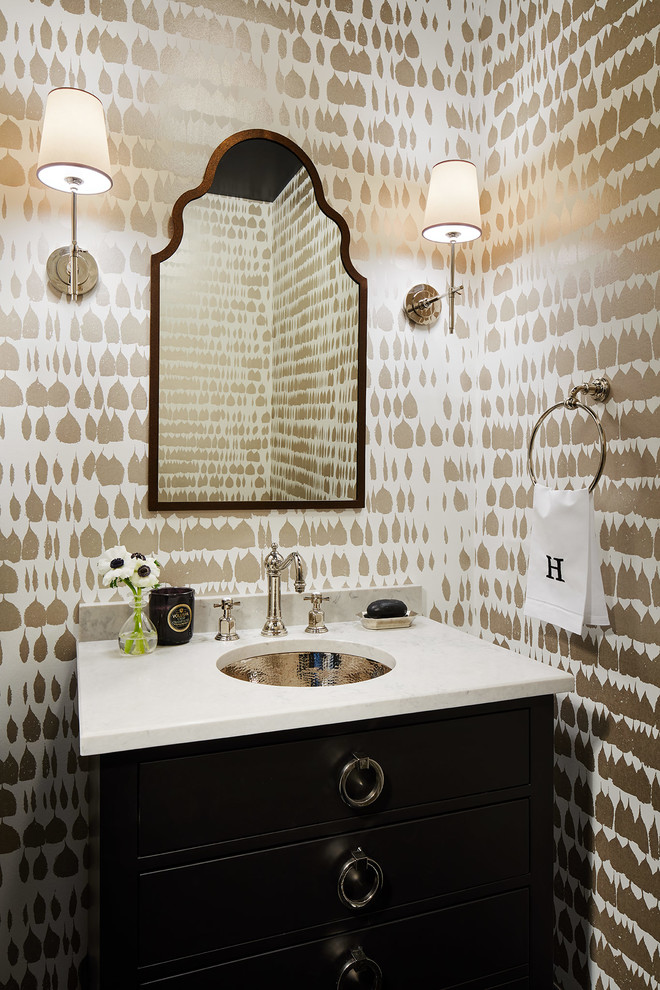 Powder room - mid-sized transitional powder room idea in Chicago with furniture-like cabinets, black cabinets, multicolored walls, an undermount sink, a one-piece toilet, quartz countertops and gray countertops