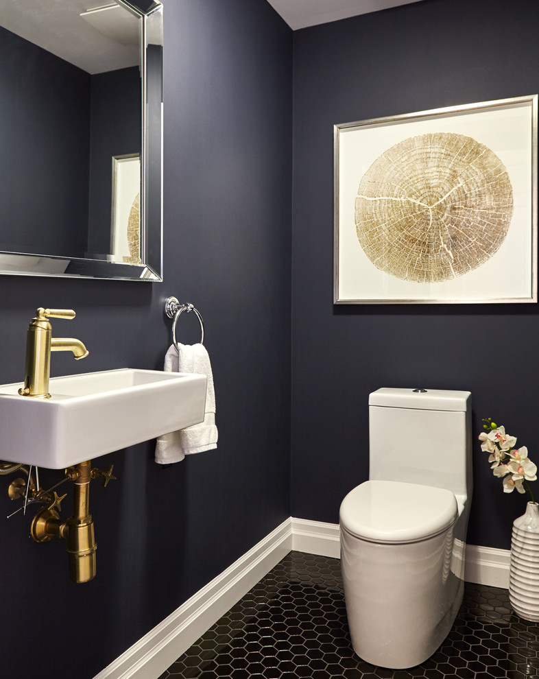 Powder room - small transitional black tile and ceramic tile ceramic tile powder room idea in Toronto with a one-piece toilet, blue walls and a wall-mount sink