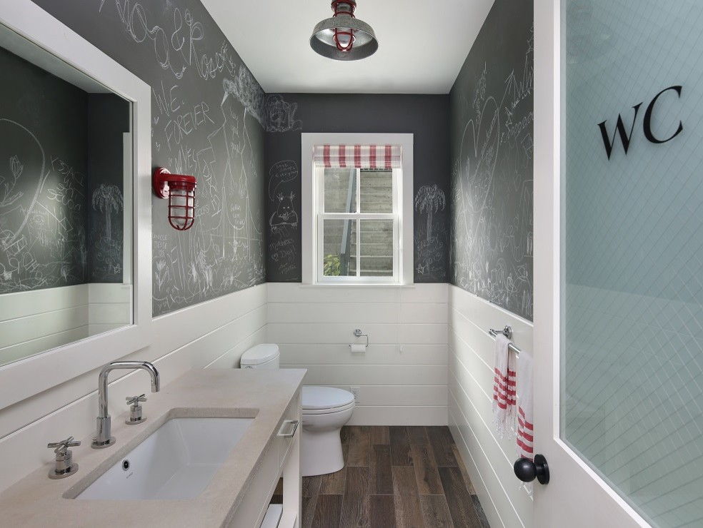 Farmhouse powder room photo in San Francisco with an undermount sink and beige countertops