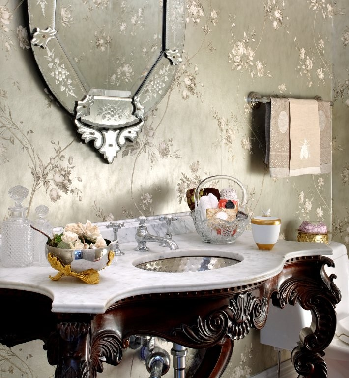Inspiration for a large timeless powder room remodel in Chicago with furniture-like cabinets, dark wood cabinets, a one-piece toilet, multicolored walls, an undermount sink and quartzite countertops