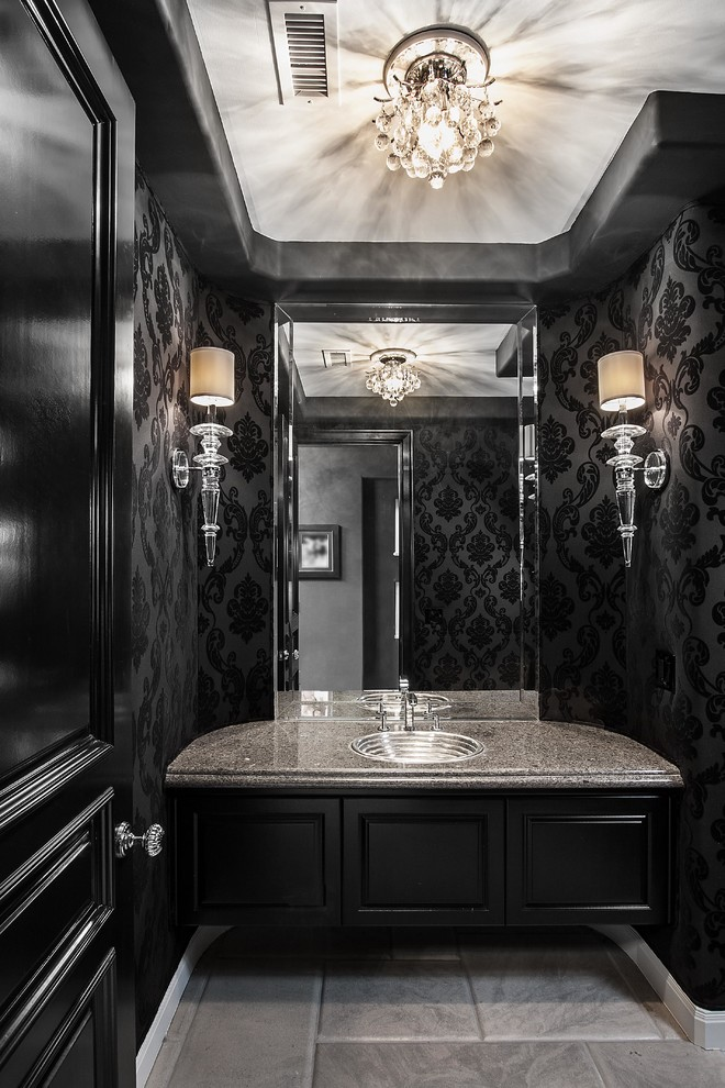 Inspiration for a contemporary powder room remodel in Orange County with a drop-in sink, black cabinets, black walls and gray countertops
