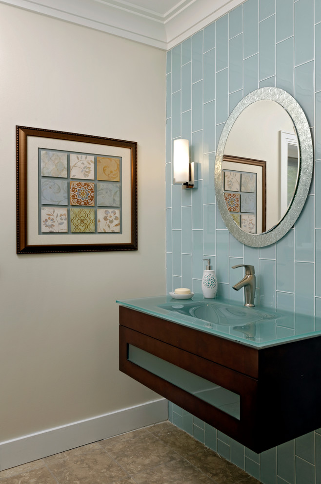 Inspiration for a mid-sized contemporary blue tile and glass tile travertine floor and beige floor powder room remodel in DC Metro with an integrated sink, flat-panel cabinets, dark wood cabinets, glass countertops, white walls and turquoise countertops