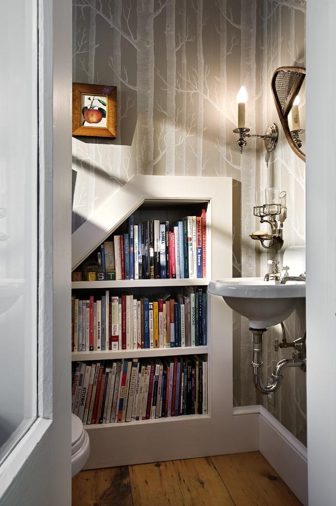 Powder room - traditional powder room idea in Burlington with a wall-mount sink