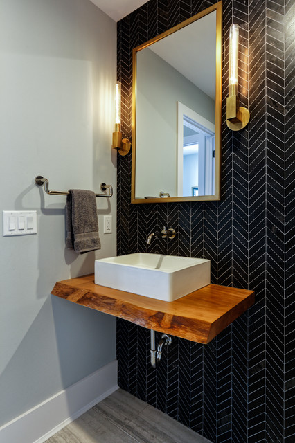 Powder room - mid-sized contemporary black tile and porcelain tile gray floor and porcelain floor powder room idea in Cincinnati with a vessel sink, wood countertops, gray walls and brown countertops