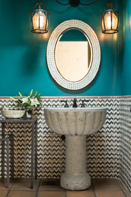 Mid-sized southwest porcelain tile and multicolored tile terra-cotta floor powder room photo in Albuquerque with a pedestal sink and blue walls