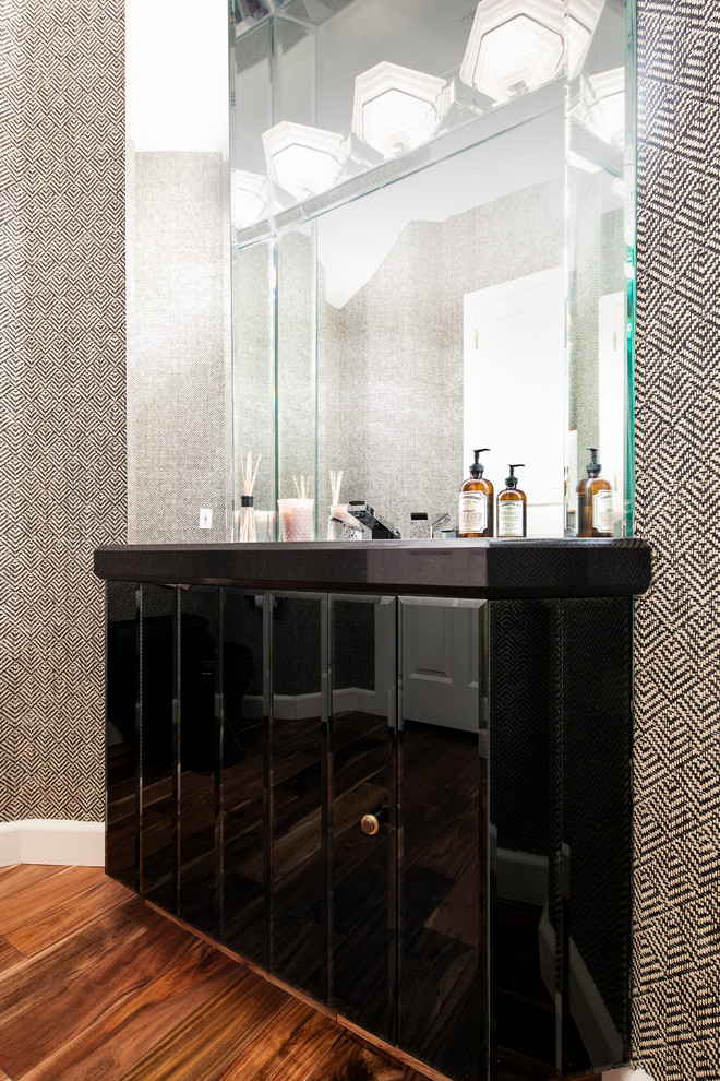 Powder room - large mediterranean medium tone wood floor powder room idea in Los Angeles with furniture-like cabinets, black cabinets, multicolored walls and an undermount sink