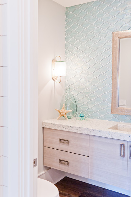 Mid-sized coastal blue tile and glass tile powder room photo in Jacksonville with flat-panel cabinets, light wood cabinets, an integrated sink and terrazzo countertops
