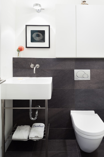Inspiration for a contemporary powder room remodel in Vancouver