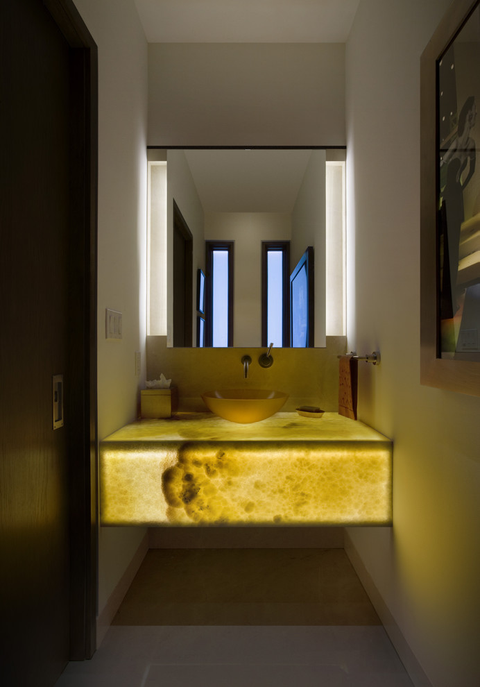 Inspiration for a contemporary powder room remodel in Denver with a vessel sink