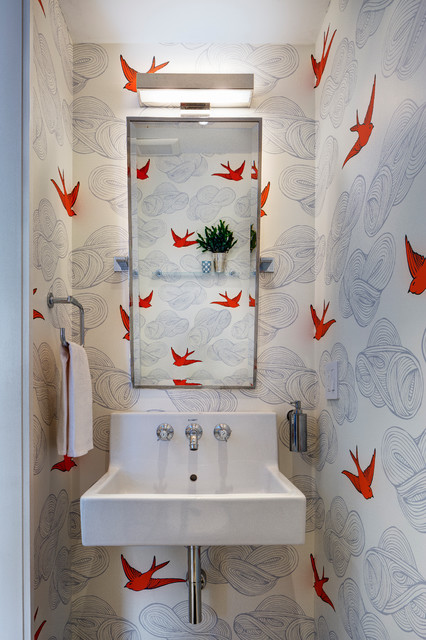 Transitional powder room photo in New York with multicolored walls and a wall-mount sink