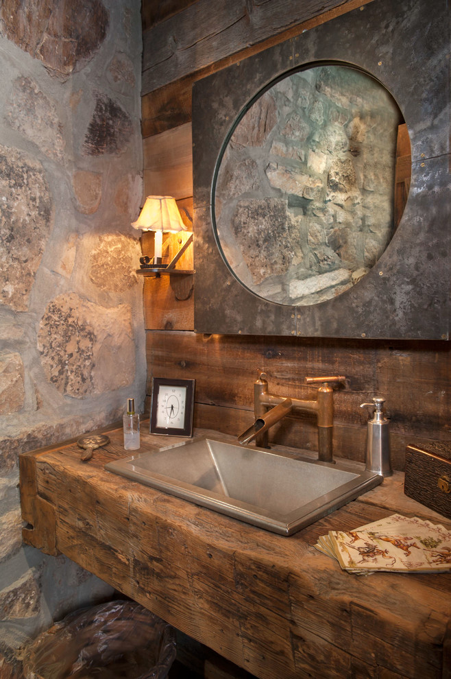 Powder room - rustic powder room idea in Salt Lake City with wood countertops, a drop-in sink and brown countertops