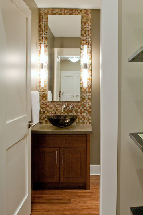 powder room with decorative tile