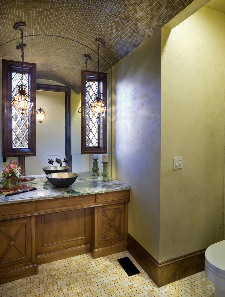 Example of a classic powder room design in Portland with a vessel sink, granite countertops and green countertops