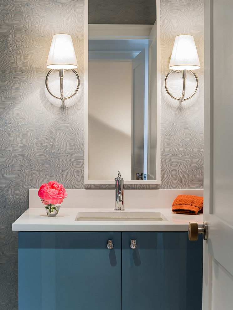 Powder room - mid-sized contemporary powder room idea in Boston with an undermount sink, flat-panel cabinets, blue cabinets, quartz countertops and white countertops