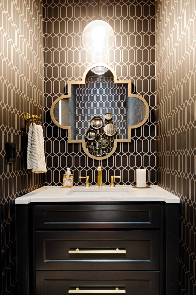 Inspiration for a small transitional powder room in Toronto with recessed-panel cabinets, black cabinets, an undermount sink, marble benchtops, brown walls and white benchtops.