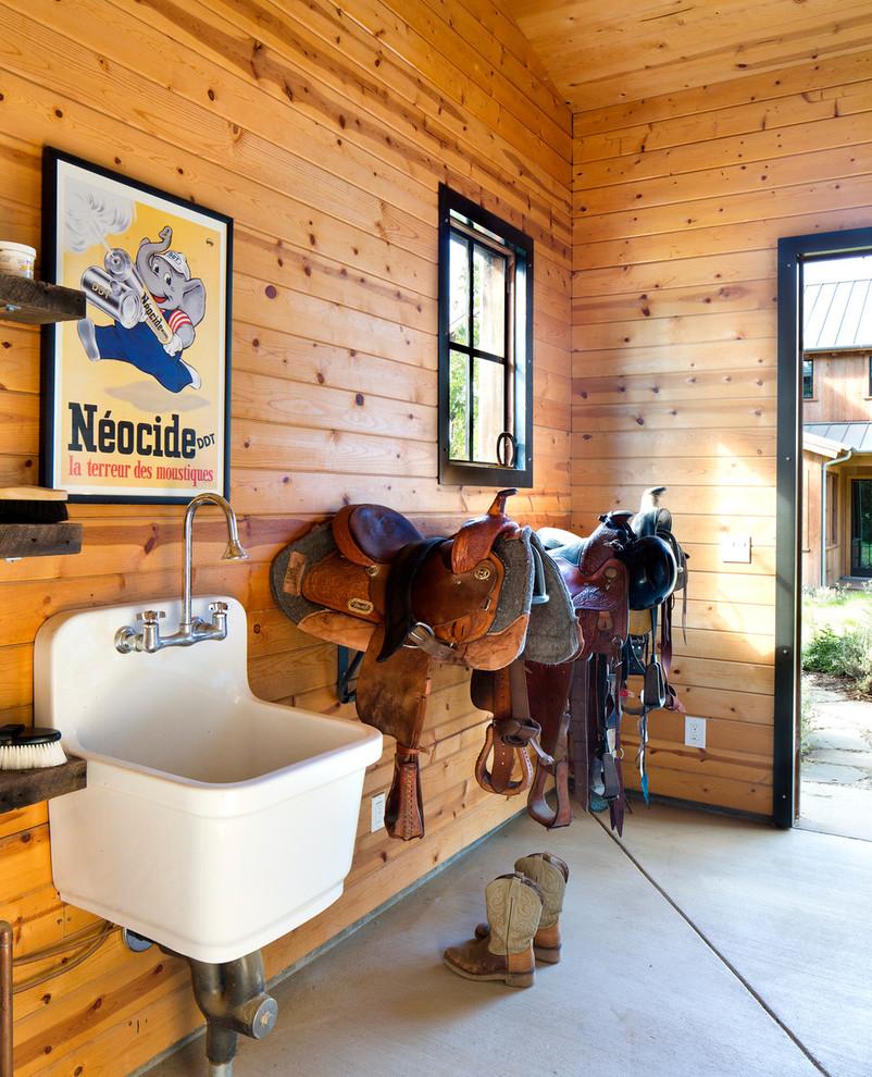 Powder room - rustic powder room idea in San Francisco with a wall-mount sink