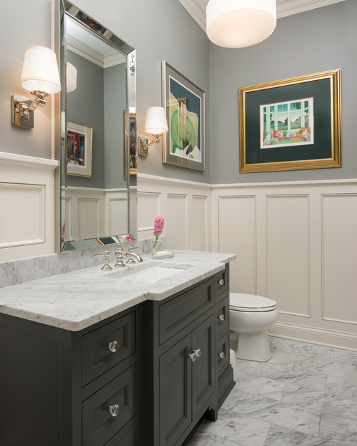 Powder room - mid-sized traditional marble floor and gray floor powder room idea in Minneapolis with recessed-panel cabinets, gray cabinets, gray walls, an undermount sink, marble countertops and gray countertops