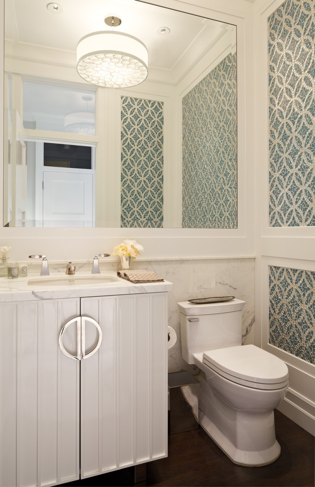 Example of an ornate blue tile and mosaic tile powder room design in San Francisco with white cabinets