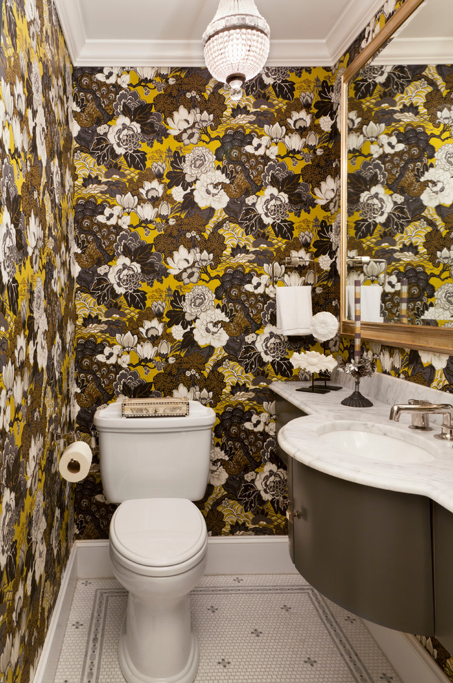 Inspiration for a small timeless mosaic tile floor and multicolored floor powder room remodel in Denver with brown cabinets, a two-piece toilet, an undermount sink, white countertops and multicolored walls