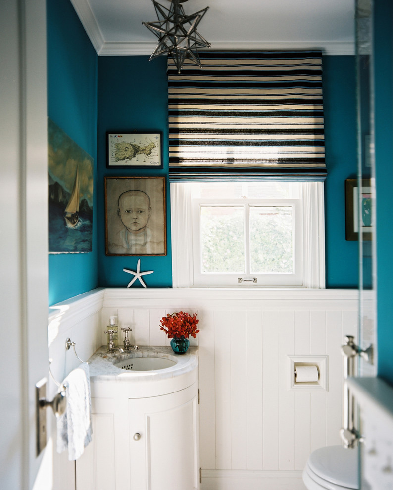 Example of an eclectic powder room design in San Francisco with an undermount sink, recessed-panel cabinets and white cabinets