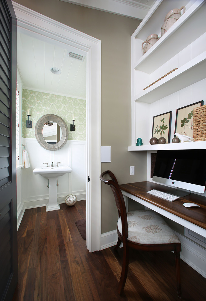 Inspiration for a tropical powder room remodel in Tampa with a pedestal sink