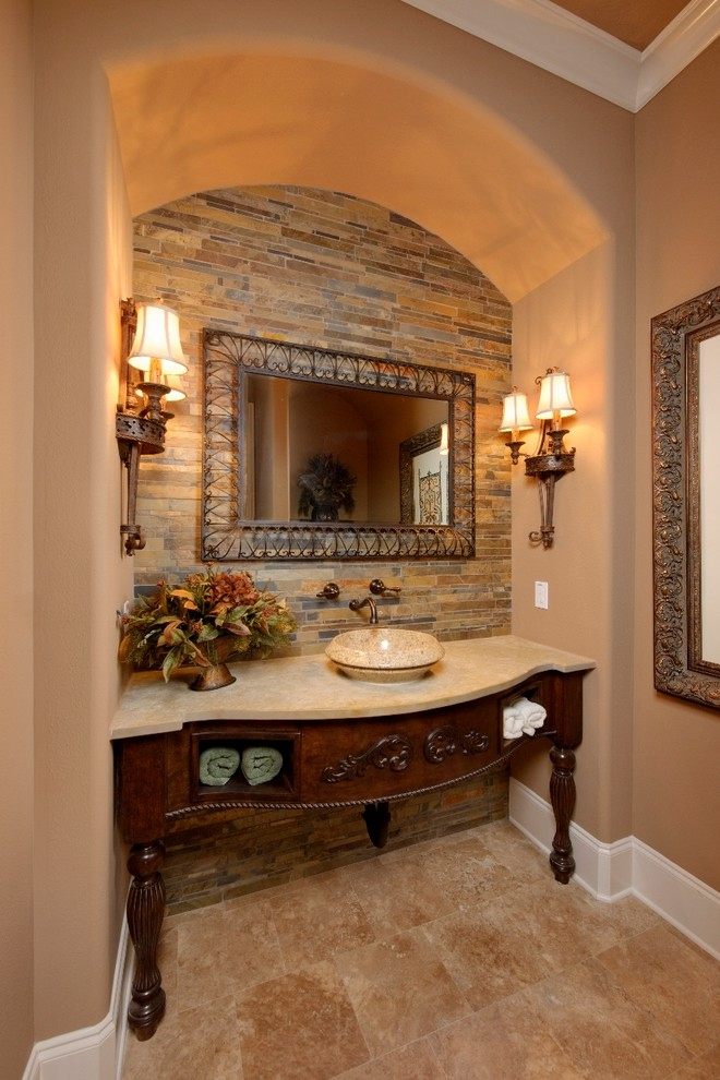 Inspiration for a mediterranean slate tile powder room remodel in Houston with a vessel sink