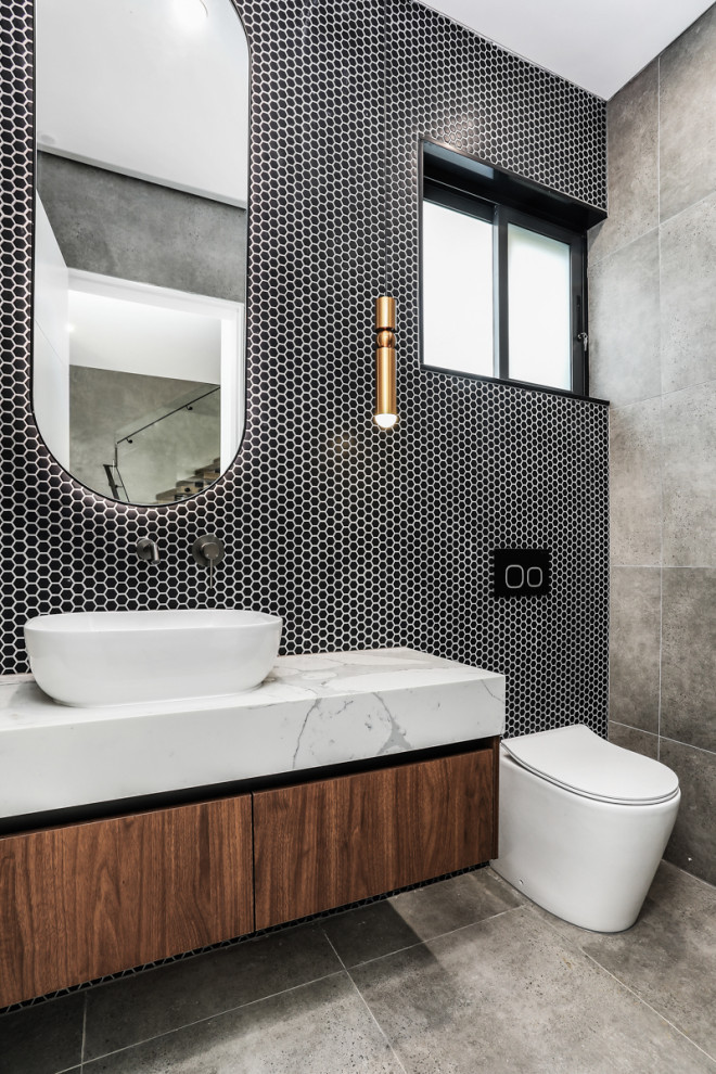 Example of a trendy powder room design in Sydney