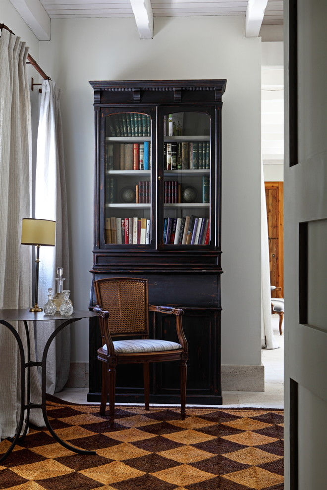 Inspiration for a mid-sized mediterranean brown floor hallway remodel in Madrid with white walls