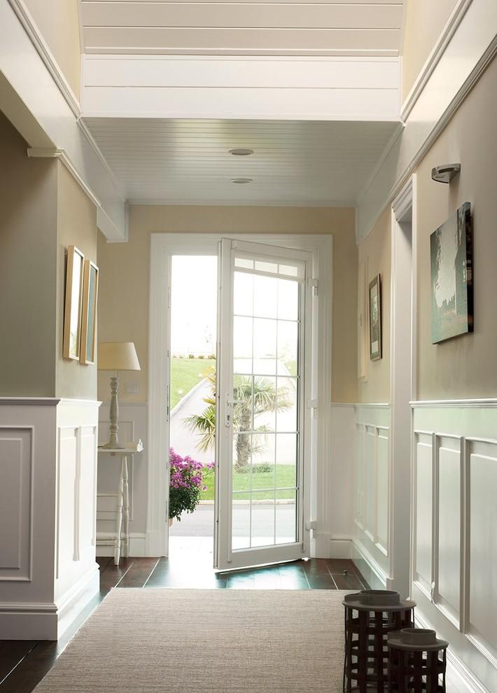 Mid-sized elegant dark wood floor hallway photo in Other with beige walls