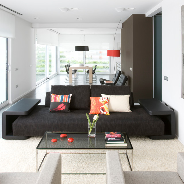 Inspiration for a large contemporary enclosed family room remodel in Other with brown walls, no fireplace and no tv