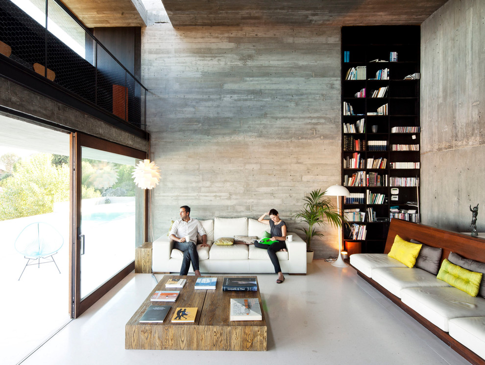 Inspiration for a contemporary family room library remodel in New York