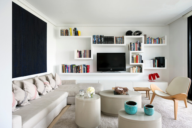 Family room - small contemporary open concept carpeted family room idea in Madrid with white walls, a tv stand and no fireplace