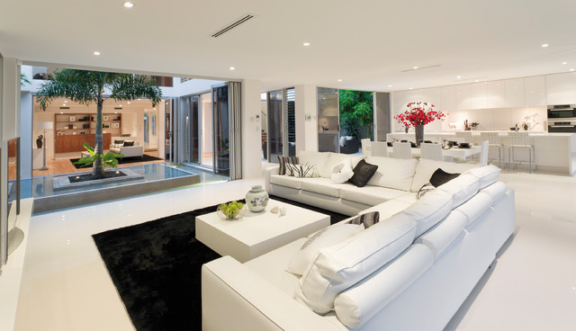 Family room - huge contemporary open concept family room idea in Other with white walls and no fireplace
