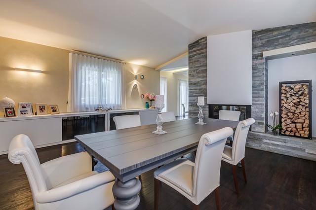 Open space in villa contemporaneo sala da pranzo for Sala da pranzo stile contemporaneo